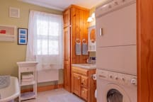 Downstairs bathroom with clawfoot tub and washer and dryer.