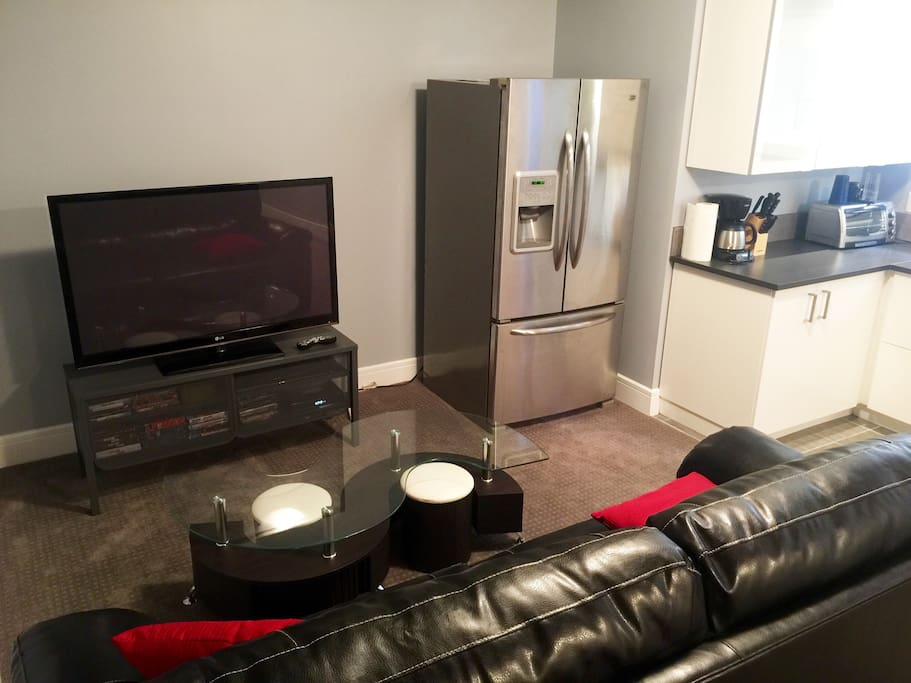 "55"" Toshiba TV and spacious double-door fridge."