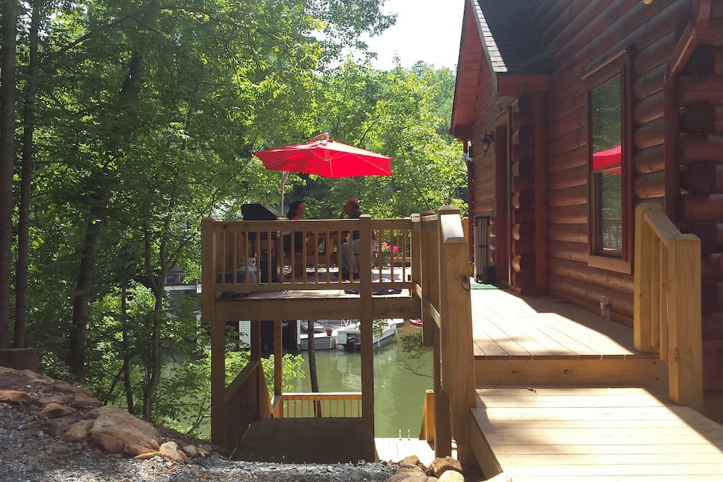 A great deck with large umbrella for grilling and dining.