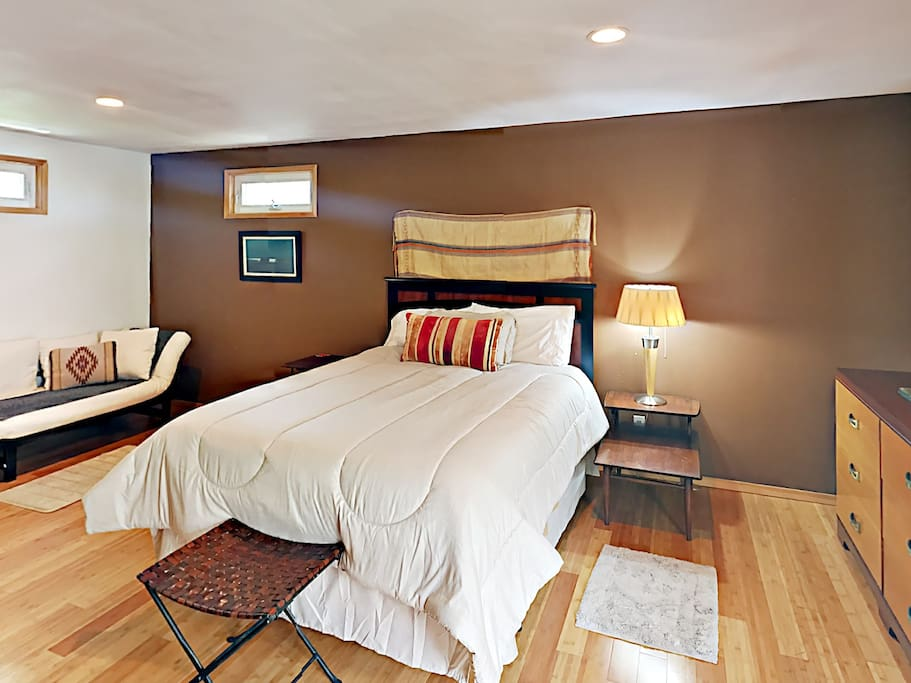 The bedroom area includes a queen-size bed