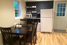 Microwave, coffee maker, fridge. Fully stocked with dishes and children's tableware.