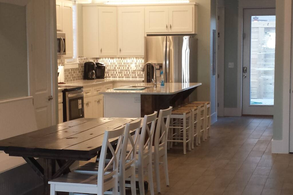 Main living space is an open concept Living room, Dining room, Kitchen w/island. 1900 square foot ground level unit--the owners unit, is also H/C friendly. Two king bedrooms, two full bathrooms, a laundry room, covered front patio with sliding glass doors from both the living room and one of the master bedrooms. This apartment is the first floor of a 3 floor house and is rented independently when not used by the owners. There is a separate and private set of entrances for this apartment, so while the top floors may also be rented to a different group, there is no shared access between the two when rented independently. The back door provides direct access to the back yard, grill and pool. That outdoor space, along with the parking in the front of the house, would be shared with guests in the upstairs unit if that one is also rented during your stay.