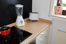 oven, microwave, blender, water kettle, dishes etc
