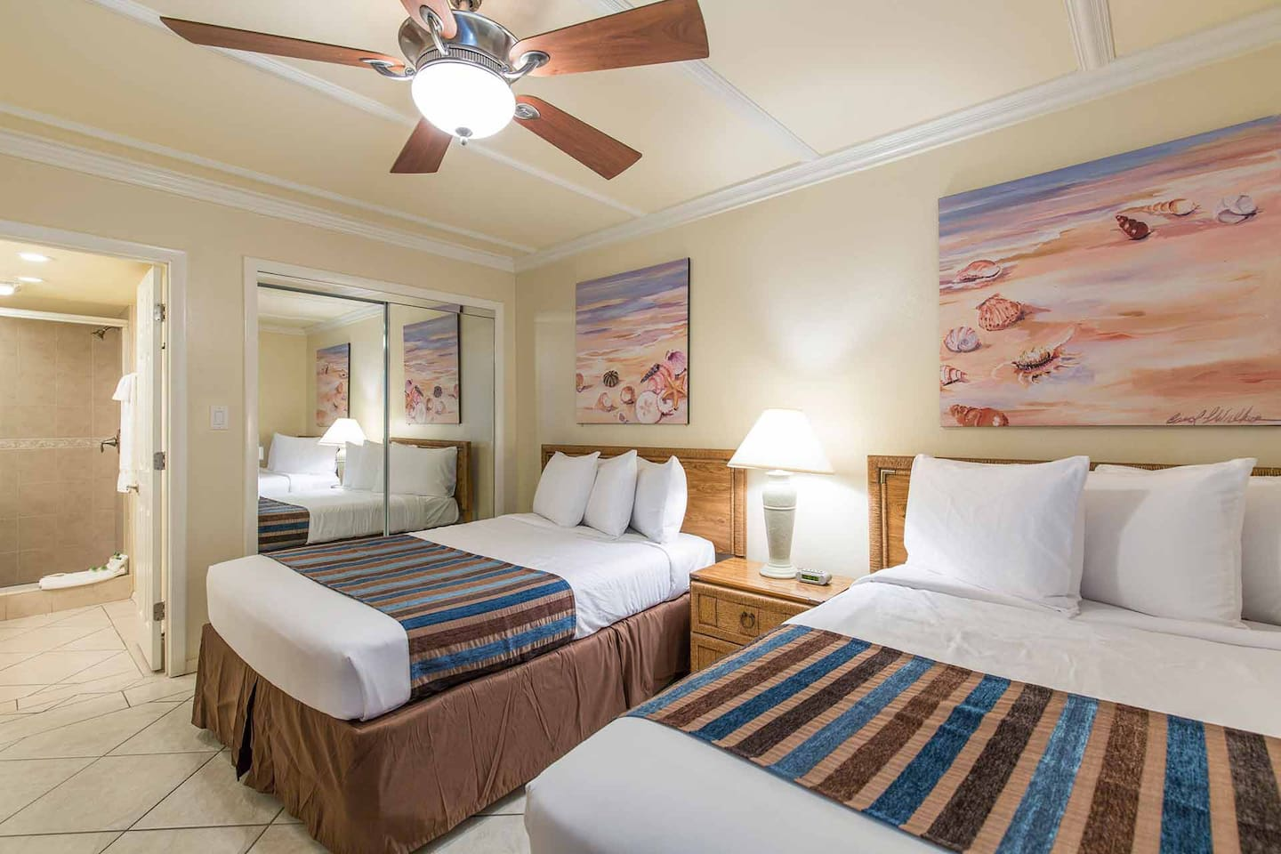 The guest bedroom has two full-size beds.