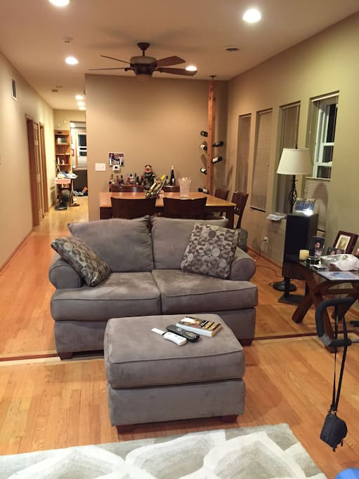 Loveseat seating area with ottoman