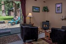 Relax and enjoy the propane fire at the White Fir Bunkhouse.