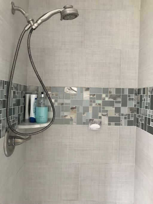 Updated shower with glass door.