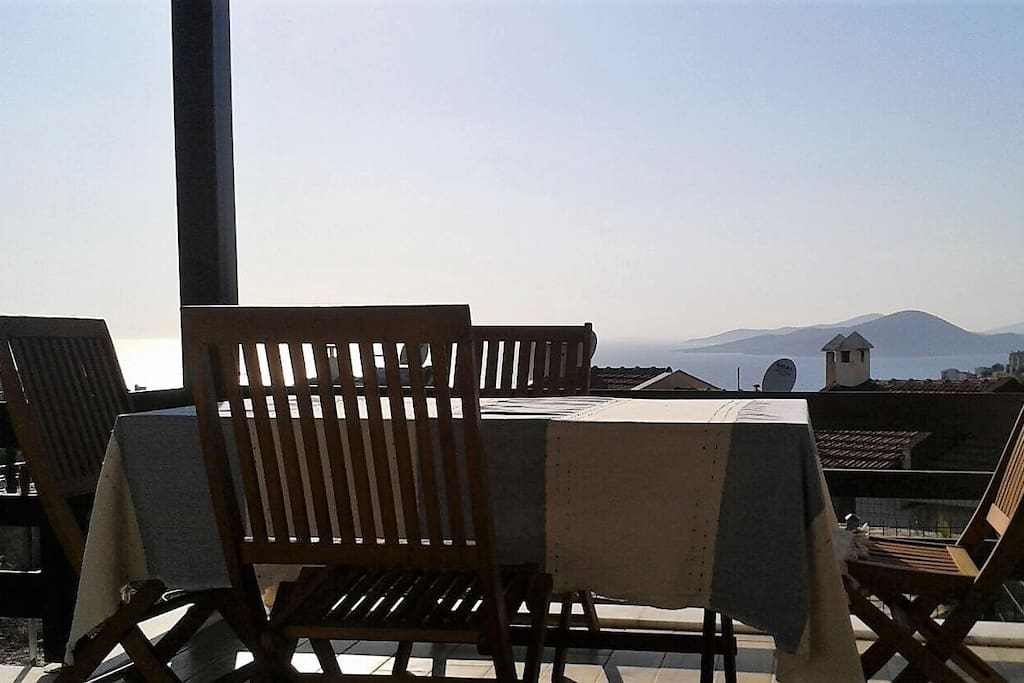 Enjoy alfresco dining on the terrace with views of the Aegean Sea