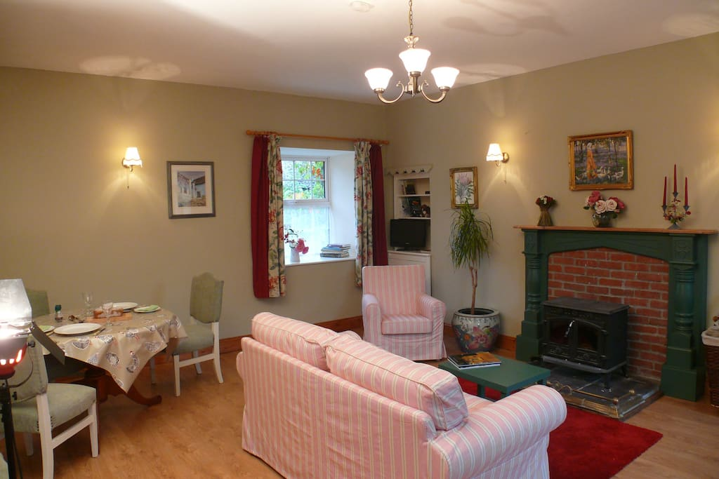 The living/dining room with wood burning stove