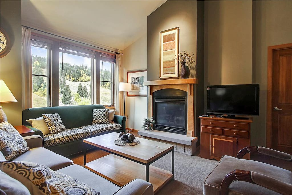 Cozy lounge area with gas fireplace, flat screen TV and views...