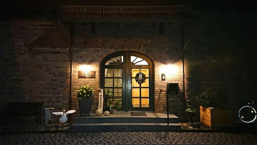 Eingang zu den Gästezimmern