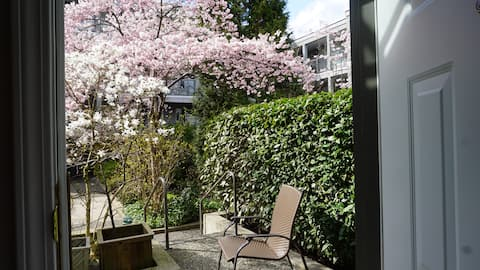 Garden access via front door with flowering trees in a gated community (Mar 2020)