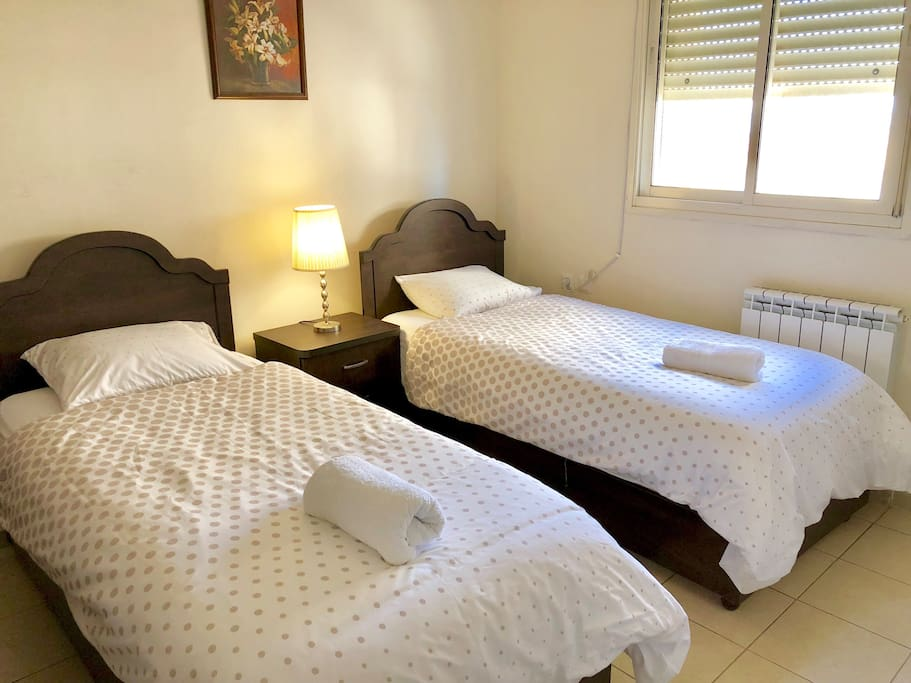 Enjoy a noise free comfortable nights sleep in this Master Bedroom with a private bathroom & shower!