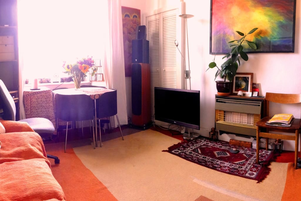 Living room space. Bright south facing room with lots of light and colour, with my original art to brighten the space :-)