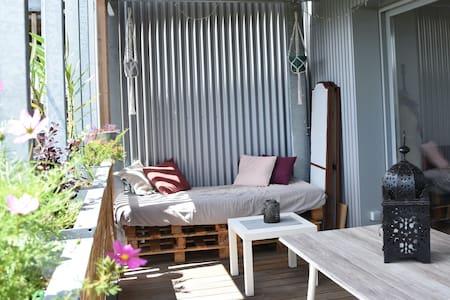 T2 50m2 avec terrasse au calme, place de parking