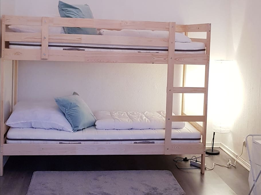 sleeping room with 4 beds