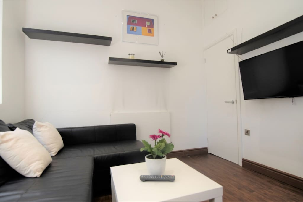 Tastefully decorated reception with wall mounted tv