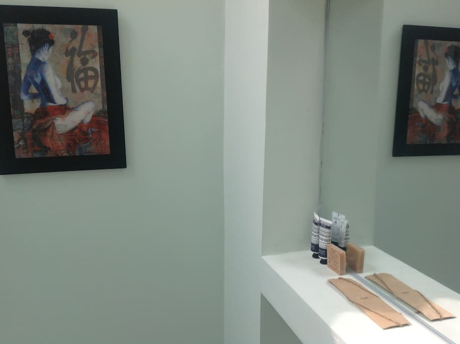 Mirror and amenities in your private bathroom