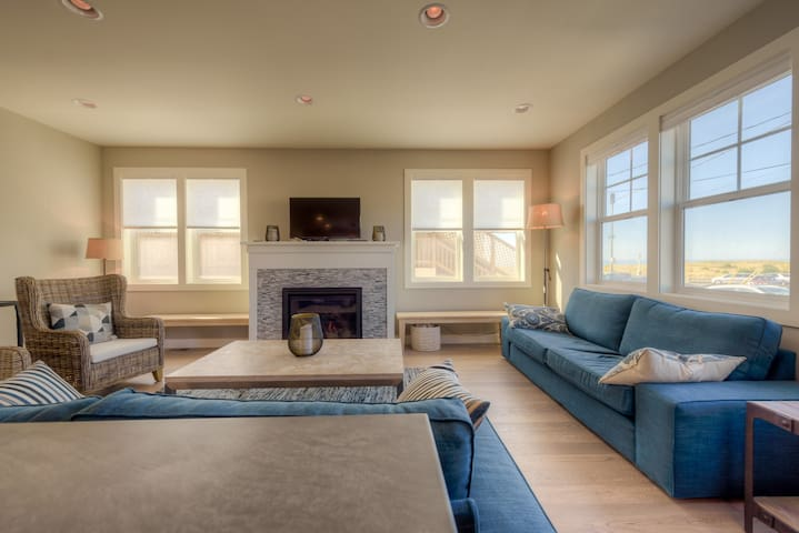 Large, open floor plan Living Room with two full size couches, two arm chairs, two benches, plenty of seating for movies and game nights! Gas fireplace and TV, Ocean View