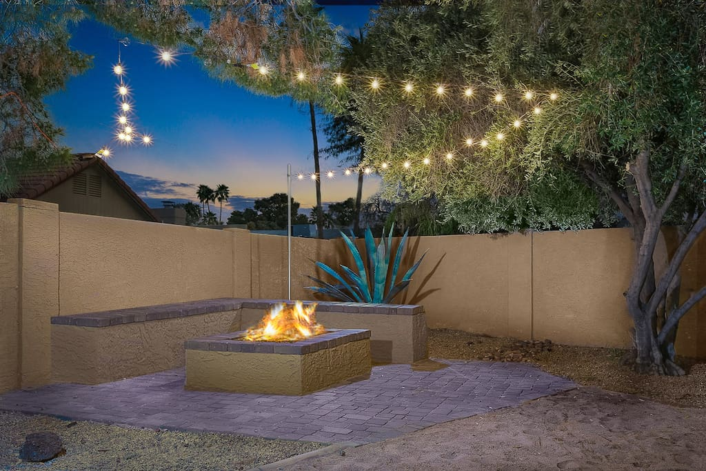 Outdoor fire pit with string lights!