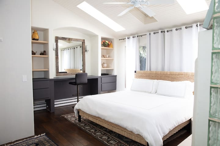Bedroom with Fireplace and Ceiling Fan