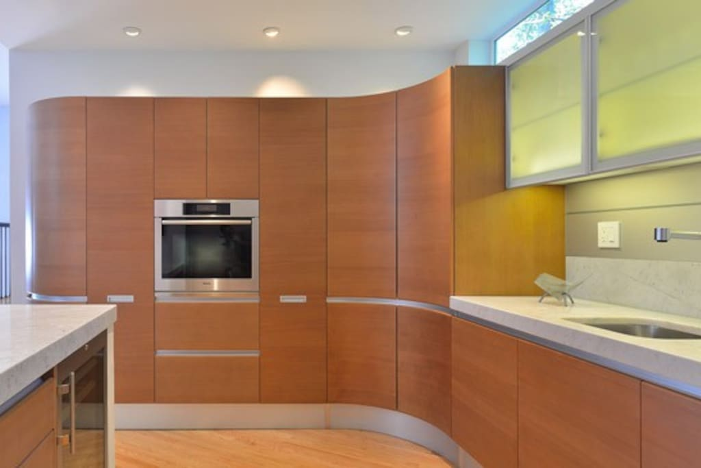 Open Kitchen with Pedini Cabinets and High End Appliances