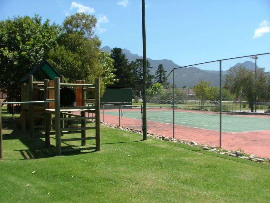 Kids play park and tennis court.