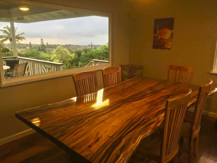 New Dinning Room with hand crafted slab table and comfortable seating for eight.