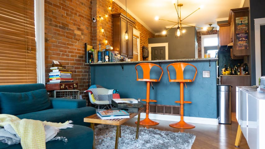 Open and airy, my exposed brick home is both funky and fun.