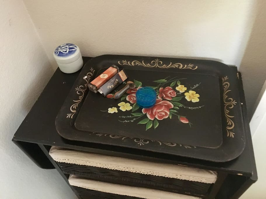 There's a weed tray with a roller, rolling papers, a grinder, and pipe so no need to pack your own.