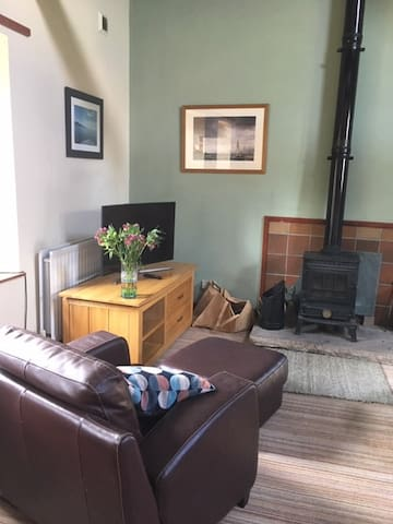 Spacious sitting room with log / coal fire,T.V , DVD player and a selection of DVDs