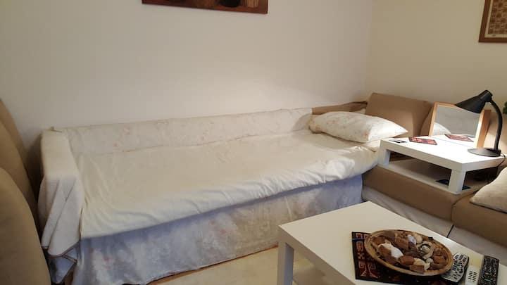 Comfy sofa, parking, TV and Wifi