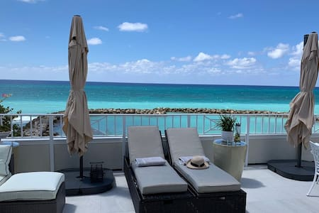 New to market, Seafront condo on Seven Mile Beach