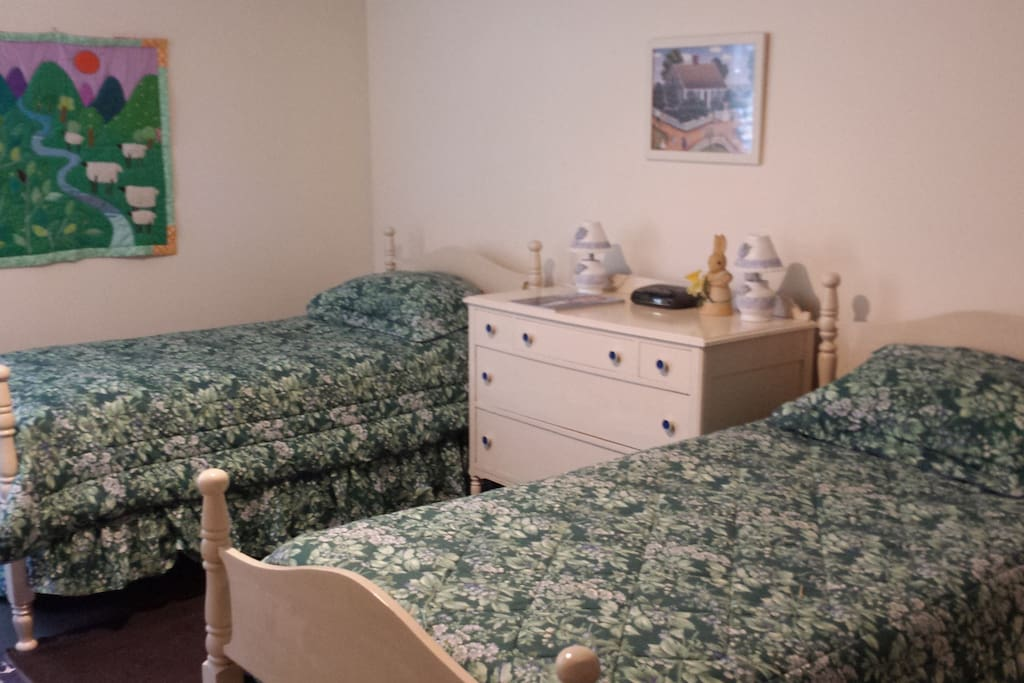 Primary bedroom with two twin beds plus a twin day bed