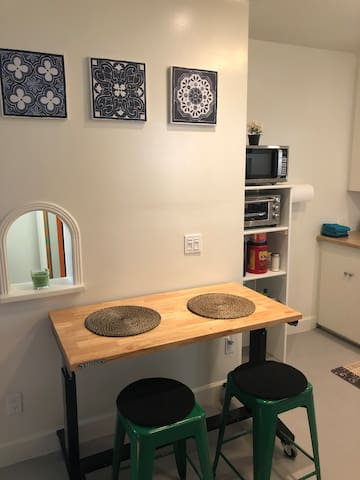 This is a fully spacious equipped kitchen with all the amenities with a rolling dinette table , and a full-size fridge microwave toaster oven coffee maker , With all the utensils and unlimited coffee sugar and creamer