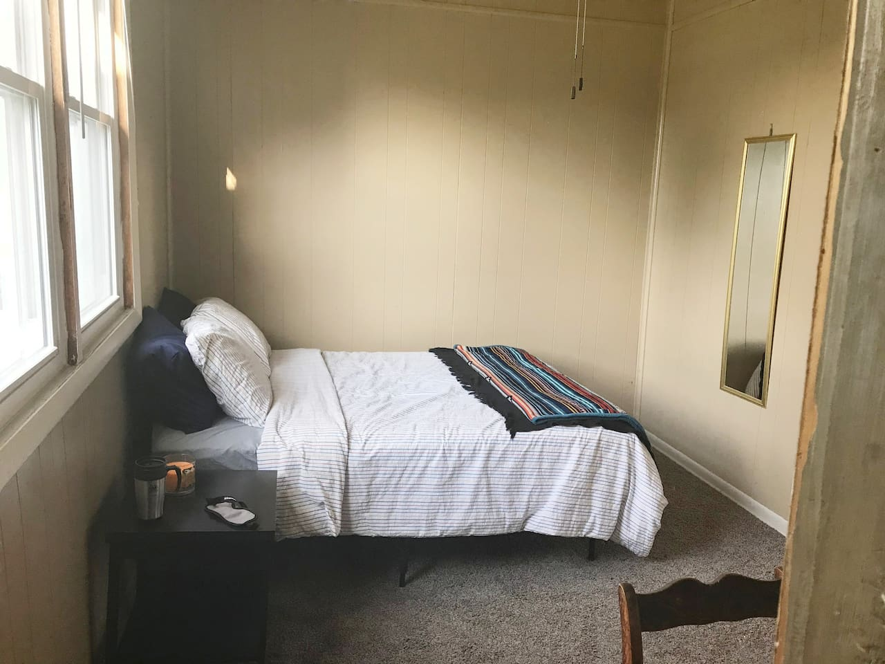 This is bedroom 1, it has one queen sized bed placed closely unto the dramatic finish wall and this would be the first thing you'll seen in entering the bedroom door. The window faces to your left and under it is a coffee table for you to enjoy.