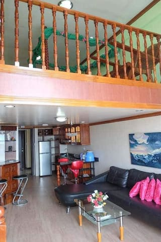 Photo shows the Loft style unit of the place,the sleeping area upstairs with one King Size Bed and 2 extra  Floor Mattresses for 2 person king size bed for 2 person .