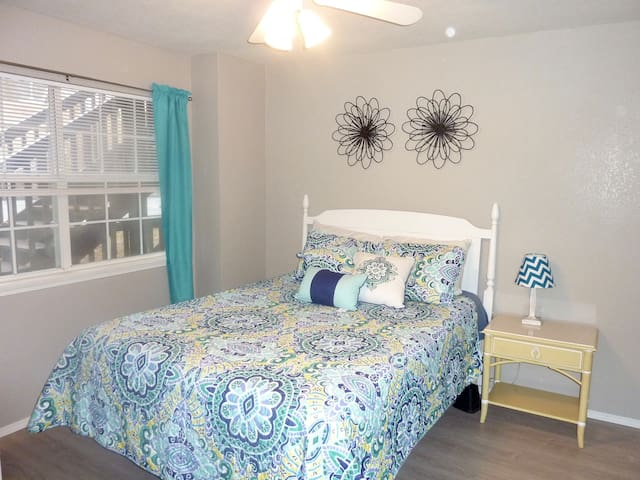 Front bedroom, queen bed with blackout curtains and private bathroom
