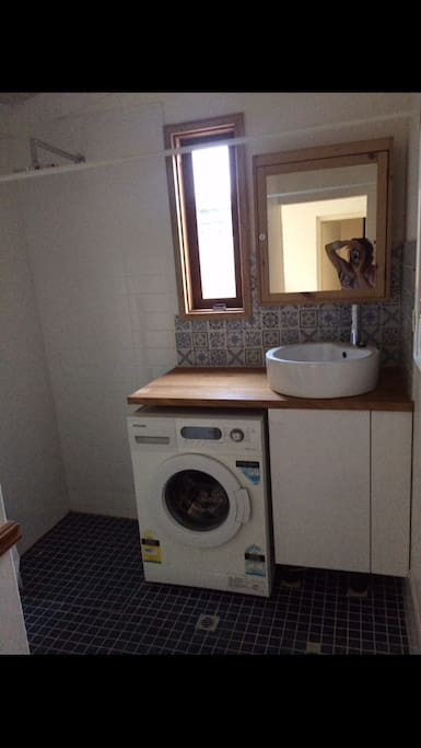 A second shower is available in the laundry