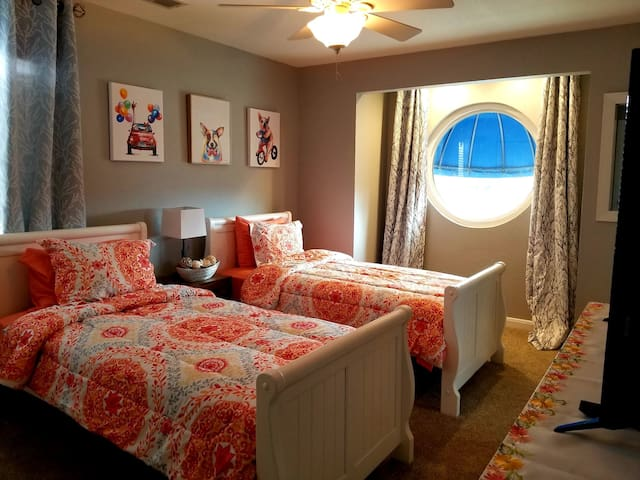 Twin size bed to accommodate two guests.