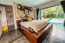 Master bedroom ground floor direct pool access with walk-in wardrobe and en suite.
