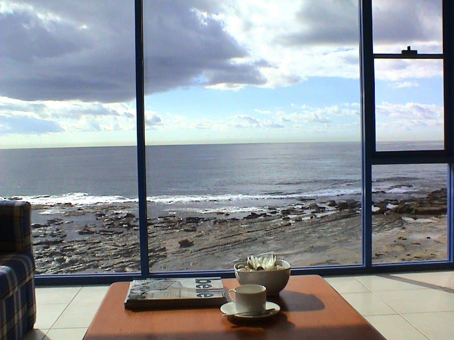 Picture window relax on lounge and watch the sunrise, electrical storms, the rolling waves, fisherman and whales