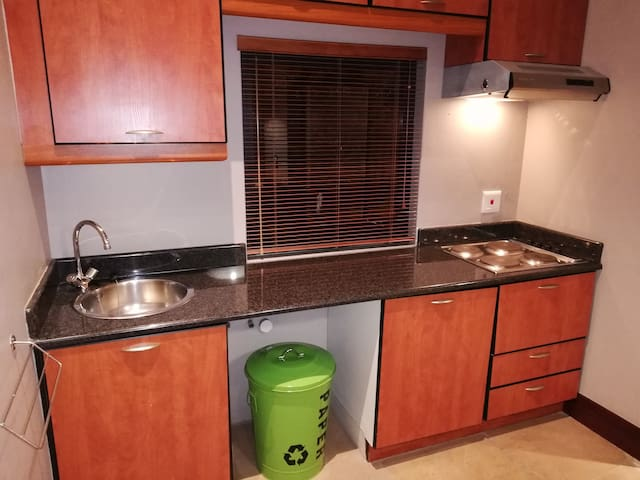 The kitchen is fully equipped; fridge, stove top, microwave and sink.