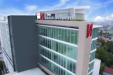 Room in Jambi by Swiss-Belhotel