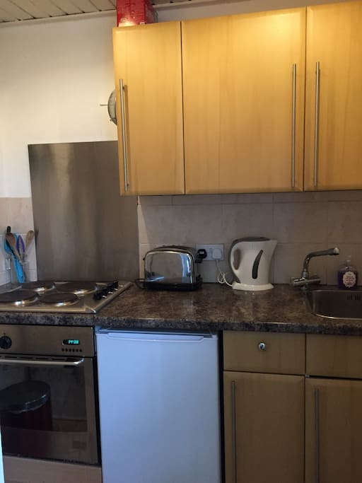 Small kitchen with hob, oven and fridge.  Complimentary Tea and Coffee
