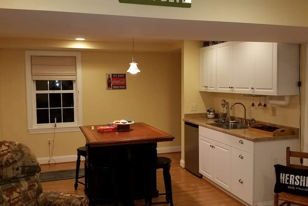 Kitchenette with Mini Fridge, sink, microwave eating table.