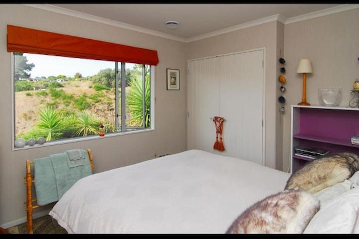 The comfortable luxury queen size bed in this room which has private garden and Tainui reserve views. Note there is another room with two single beds available that has views to Ruahine ranges (and Mt Ruapehu can be seen on a clear day also).