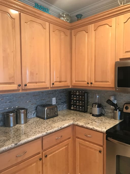 New granite, and backsplash with custom cabinets
