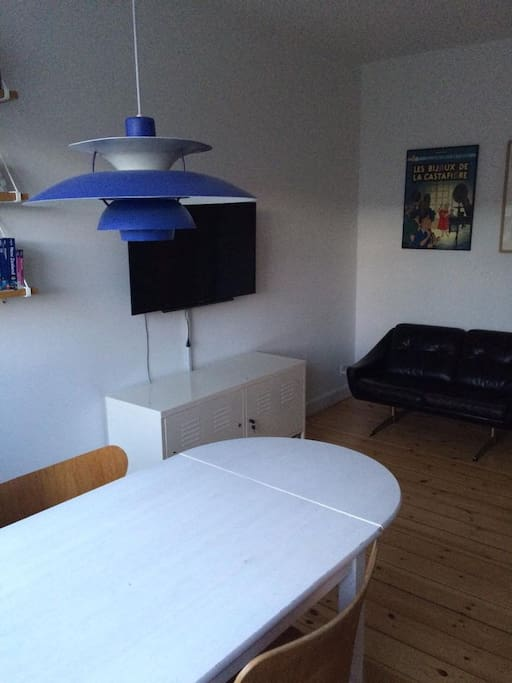 Dining, TV and small sofa