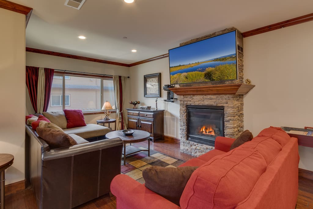 65inch HD TV surrounded by comfy sofa seating